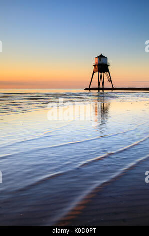 A victorian lighthouse in Dovercourt at dawn - Harwich, Suffolk, UK. - Stock Photo