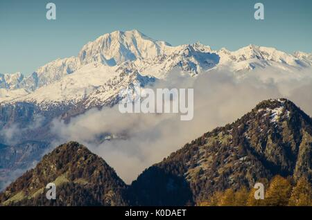 Mont Blanc it's rising, over the clouds and the ridges, in the panorama. (Val d'Ayas, Vallée d'Aoste, Italy) - Stock Photo