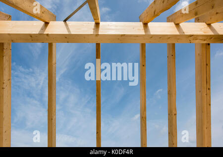 framework of new built roof on residential house in construction - Stock Photo