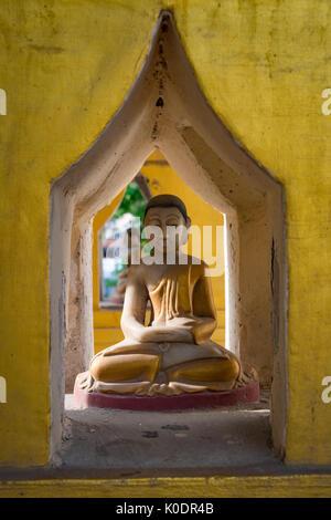 Buddhist shrine in the Setyyanthiha Paya temple, Mandalay, Myanmar - Stock Photo
