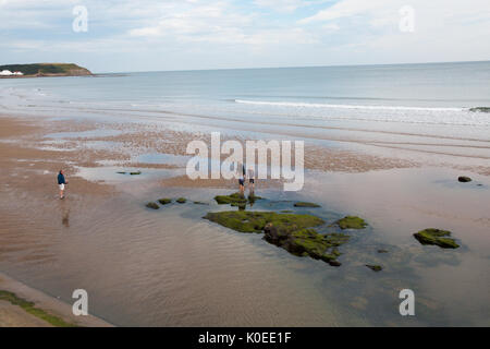 Family rock pooling at North Bay Beach, Scarborough - Stock Photo