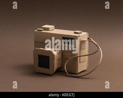 Creative handmade camera made from recycled cardboard, crafts and creativity concept - Stock Photo