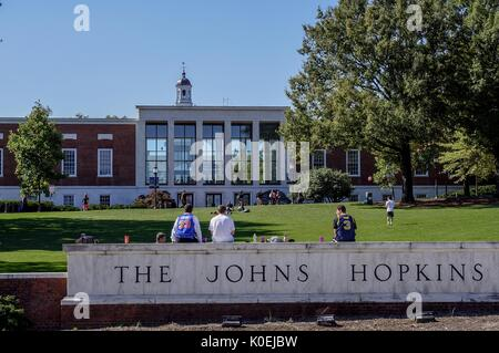 A view from Charles street of the grassy 'Beach' and Milton S Eisenhower Library of the Johns Hopkins University; - Stock Photo