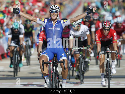 Italian cyclist of Quick Step team Matteo Trentin celebrates his victory in the fourth stage of La Vuelta cycling - Stock Photo