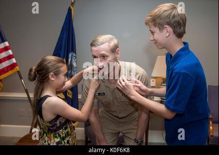 Washington, United States. 23rd Aug, 2017. U.S. Navy Vice Adm. Joseph Aucoin, has his children put on his new three - Stock Photo