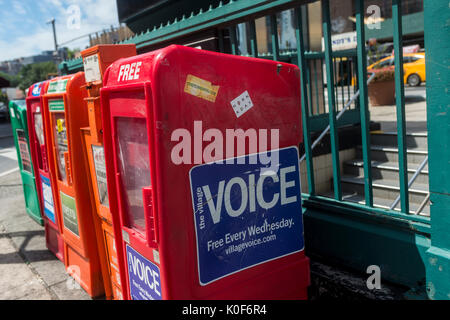 New York, NY, USA. 23rd Aug, 2017. Newspaper boxes outside the subway station in Sheridan Square, across the street - Stock Photo