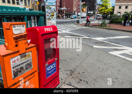 New York, NY, USA. 23rd Aug, 2017. Newspaper boxes in Sheridan Square, across the street from 61 Christopher Street, - Stock Photo