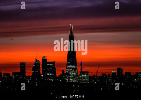 London, UK. 23rd August, 2017. UK Weather: The Shard skyscraper seen during a colourful sunset © Guy Corbishley/Alamy - Stock Photo