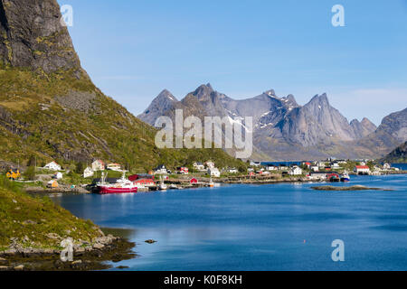View across the natural fishing harbour to mountains. Reine, Moskenes, Moskenesøya Island, Lofoten Islands, Nordland, - Stock Photo