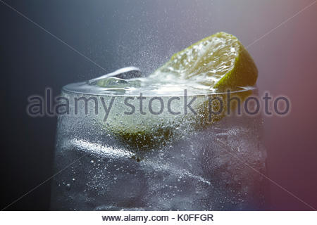 Fizzy Gin and Tonic drink with Lime - Stock Photo