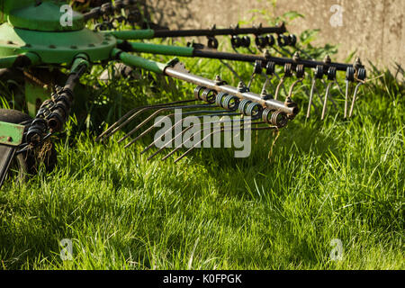 Abandoned hay turn on a meadow - Stock Photo