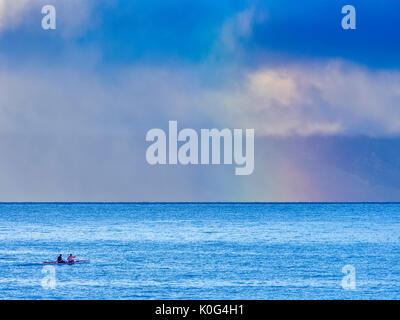 Sunrise over Molokai seen from Maui Hawaii - Stock Photo