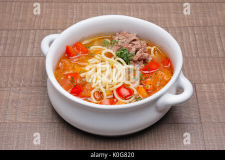 Portion of lagman in ceramic plate - Stock Photo