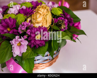 Close up of a bouquet of colorful flowers on the table. - Stock Photo