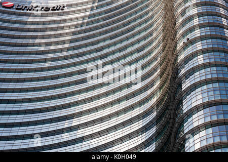 UniCredit Tower in the Porta Nuova District, Milan, Lombardy, Italy. Exterior view of curved glass facade of the - Stock Photo