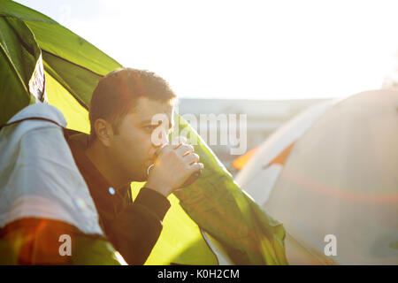 Photo of man in tent - Stock Photo
