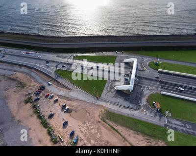 Sandy beach and sea is near the entrance to vehicular underground tunnel under the navigable passageway C1. Dam - Stock Photo