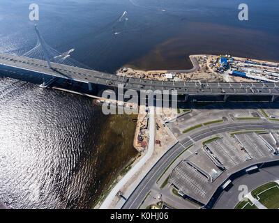 Western High Speed Diameter (WHSD) passing on Krestovsky Island near Zenit Arena sport stadium. Viaduct above sea. - Stock Photo