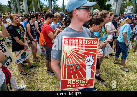 Miami Florida Museum Park March for Science protest rally sign poster protester teen boy student - Stock Photo