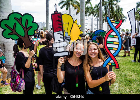 Miami Florida Museum Park March for Science protest rally sign poster protester teen girl student friends - Stock Photo