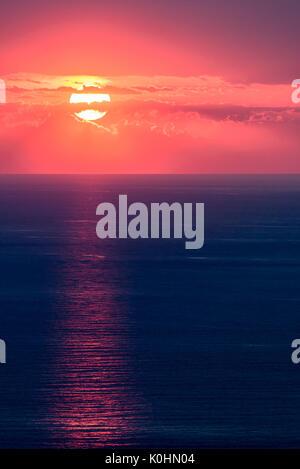 Zambrone, Vibo Valentia, Calabria, Italy. Glowing sunset over the Tyrrhenian sea - Stock Photo