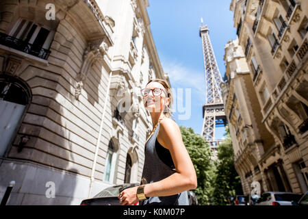 Woman walking in Paris - Stock Photo