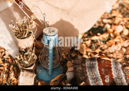kerosene lamp. old tent in the autumn forest, home for adventure and travel - Stock Photo