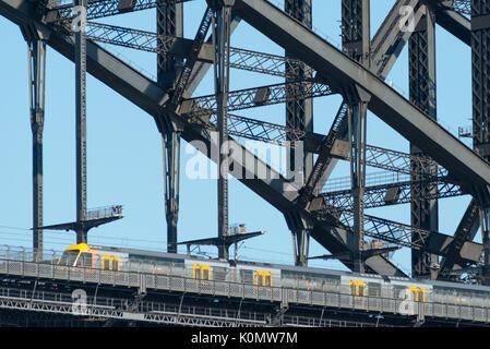 A train travelling across Sydney Harbour Bridge, Sydney, Australia. - Stock Photo