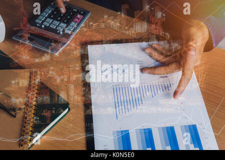Double exposure of financial and offshore oil and gas platform background concept.  Hand business man work to calculate - Stock Photo