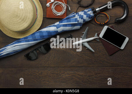 Above view of accessory to traveler for raining day or sunshine with transportation concept.Mix variety of equipment - Stock Photo