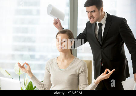 Calm attractive businesswoman meditating in office, ignoring ang - Stock Photo
