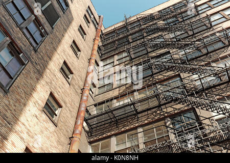 External fire escape steel stairs/platforms attached to the exterior of an old office building in Cleveland, Ohio, - Stock Photo