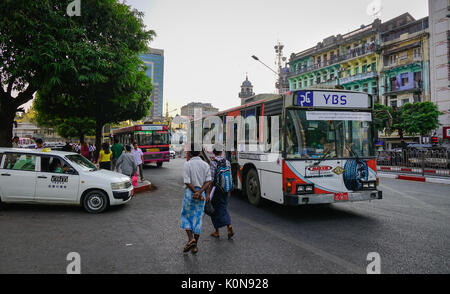 Yangon, Myanmar - Feb 13, 2017. People and vehicles on street in Yangon, Myanmar. Yangon is the country main centre - Stock Photo