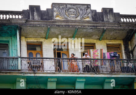 Yangon, Myanmar - Feb 13, 2017. People at an old apartment at downtown in Yangon, Myanmar. Yangon is the country - Stock Photo