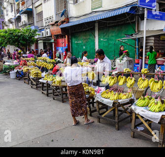 Yangon, Myanmar - Feb 13, 2017. People selling banana at street market in Yangon, Myanmar. Yangon is the country - Stock Photo