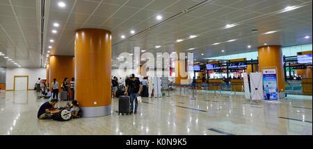 Yangon, Myanmar - Feb 14, 2017. People at Departure Terminal of Yangon Airport in Myanmar. Yangon Airport is the - Stock Photo