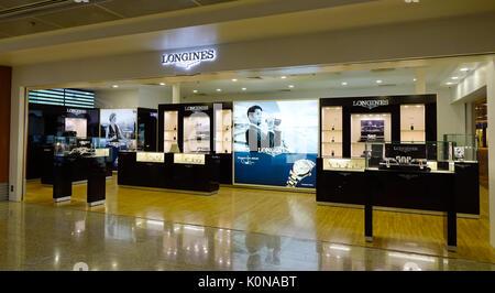 Yangon, Myanmar - Feb 14, 2017. Longines Store at Yangon International Airport in Myanmar. Yangon Airport capacity - Stock Photo