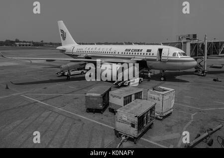 Yangon, Myanmar - Feb 14, 2017. Air China aircraft at the Yangon Intl Airport in Myanmar. Yangon Airport capacity - Stock Photo