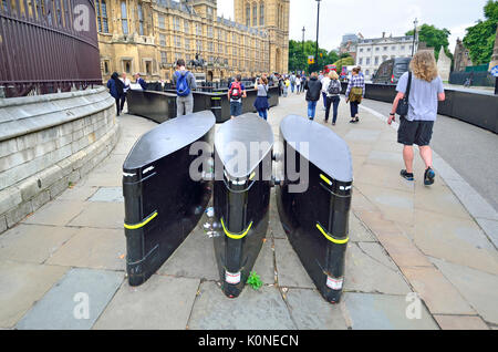 London, England, UK. Anti-terrorist barriers installed on the pavement outside Parliament in Westminster - Stock Photo