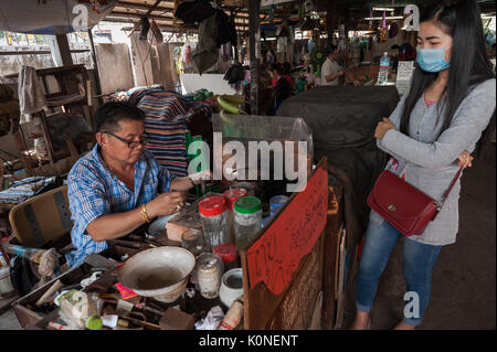 The traditional goldsmith craft is cultivated in the capital of Laos. In Vientiane's Talat Sao Market the local - Stock Photo