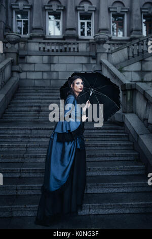 Victorian lady in blue - Stock Photo