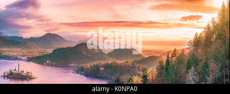 Panoramic view with the Bled island, the lake and the surrounding hills, in amazing colors due to the sunrise. Slovenia - Stock Photo