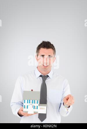 Digital composite of Business man holding keys - Stock Photo