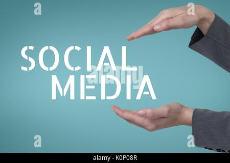 Digital composite of Hands interacting with social media business text against blue background - Stock Photo