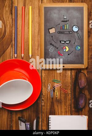 Digital composite of Table top with a blackboard with web graphics - Stock Photo