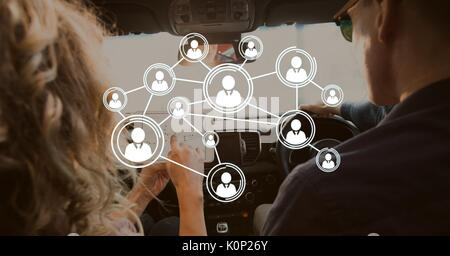Digital composite of Interface against couple in the car - Stock Photo