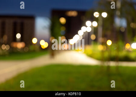 Night view of new modern residential district with park. Eco-friendly living in a city. - Stock Photo