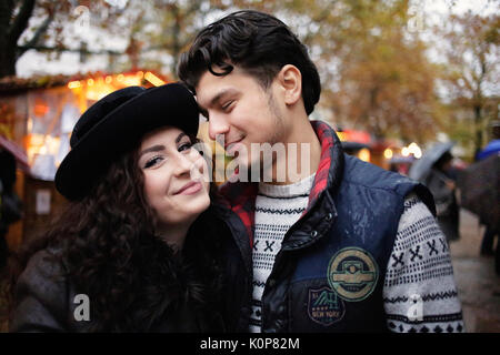 Young couple at a christmas market - Stock Photo