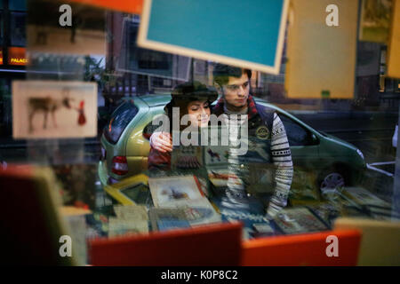 Young couple going window shopping in pre-christmas period - Stock Photo