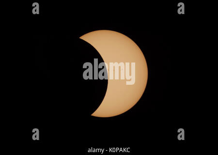 The Moon continues to pass the Sun's disk in the second partial eclipse phase of the Great American Eclipse on August - Stock Photo